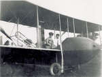 Katharine and Orville Wright sitting in Wright Model H Flyer