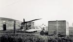 Wright Model B Flyer sitting next to Huffman Prairie hangar
