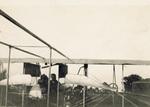 Three men working on Wright Model B Flyer