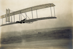 Wright 1902 glider being flown from Big Kill Devil Hill by Wright Brothers