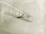 Wilbur Wright gliding in the Wright 1902 glider by Wright Brothers