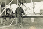 "Orville Wright standing in front of his ""personal"" Flyer"