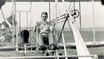 Oscar A. Brindley seated in a Wright Model B Flyer
