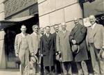 Orville Wright with group outside railroad station