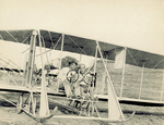 Rinehart with another pilot seated in Wright Model B Flyer by Ovid Reeder