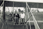 Rinehart and Brewer sitting in Wright Model B Flyer