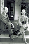 Wilbur and Orville Wright seated on porch