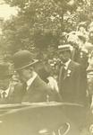 Wilbur and Reuchlin Wright in the middle of a crowd