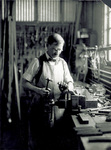 Charlie Taylor working at a vise
