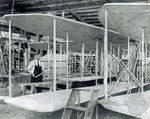 Albert M. Flora at work assembling wings