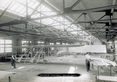 Historic photo showing airplanes being built in the Wright Company factory in 1911.