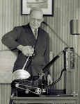 Charlie Taylor with his half-scale reproduction of 1903 engine