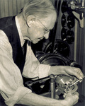 Charles E. Taylor working on half-scale reproduction of 1903 engine