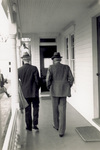 Orville Wright and Henry Ford walking on the porch of the Wright home