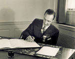 Edsel Ford signing guest book