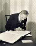 Henry Ford signing guest book