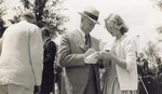Orville Wright signing an autograph for an admirer