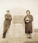 William Tate and his daughter at first flight stone marker