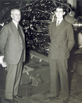 Orville Wright and his nephew at Ford engine assembly plant