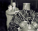 Captain W. S. Forbes and Orville Wright examining airplane engine