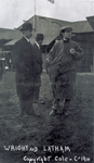 Orville Wright standing with Hubert Latham.