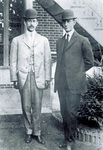 Orville and Wilbur Wright standing in Bollee garden