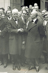 Secretary Whiting shaking hands with Orville Wright