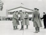 General Bowley shakes Major Kepner's hand