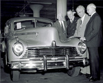 Viewing first 1946 model Hudson automobile off assembly line