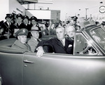 General Kenny, Orville Wright, and others riding in automobile