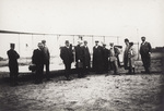 A group of reporters in front of Wright Flyer