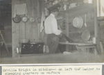 Orville Wright working in camp kitchen