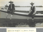 Orville, Lorin and Horace Wright sitting on boat