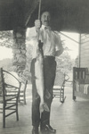 Orville Wright holding a Fish