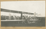 Brewer and Orville Wright Seated in Flyer