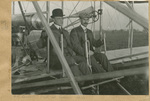 Lambert and Orville Wright Seated in Flyer