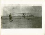 Edward Korn Standing Near a Farman Biplane, circa 1911