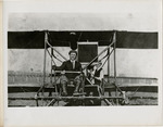 Edward Korn at the Controls of a Farman Biplane, circa 1911