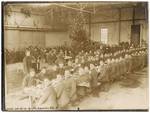 Men and women in mess hall with Christmas tree