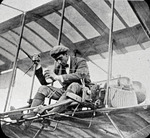 Claude Grahame-White sitting in a Farman biplane in a Curtiss aircraft at the Harvard-Boston Aero Meet, September, 1910