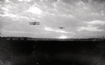 Two unidentified biplanes flying at the Harvard-Boston Aero Meet by Anthony Philpott