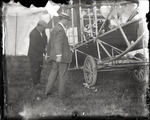 Wilbur Wright looking over a Wright Model A Flyer at the Harvard-Boston Aero Meet, September, 1910