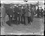 Claude Grahame-White, Clifford Harmon, and Charles Taylor with others at the Harvard-Boston Aero Meet, September, 1910