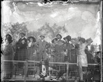 Spectators standing by a fence at the Harvard-Boston Aero Meet, September, 1910