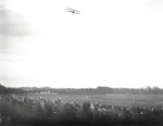 Lincoln Beachey flying over a racetrack in Saugus, Massachusetts during the Harvard-Boston Aero Meet, August - September, 1911