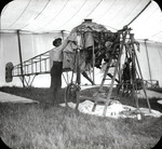 Mechanic working on Bleriot monoplane at the Harvard-Boston Aero Meet, August - September, 1911