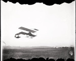 Claude Grahame-White and Anthony Philpott flying in a Farman biplane above the field at the Harvard-Boston Aero Meet, September, 1910
