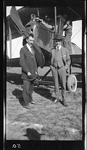 Guy Gilpatric and Art Heinrich Standing by a Standard J-1 Trainer, 1916