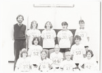 Girls' basketball team posing