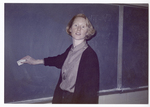 Ms. Harris erasing blackboard